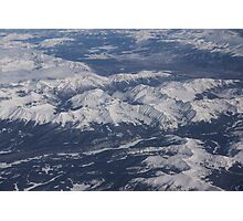Flying Over the Snow Covered Rocky Mountains Photographic Print