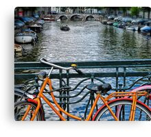 Amsterdam canal and orange bicycle Canvas Print