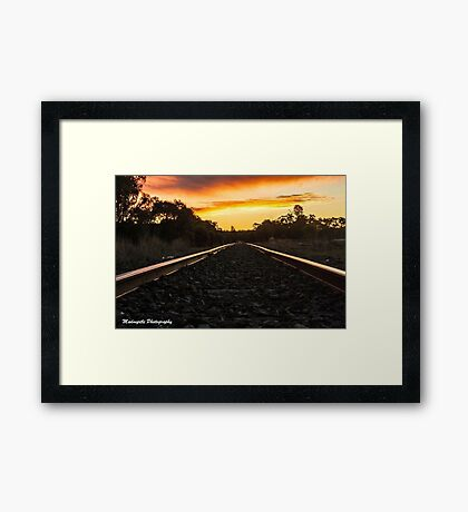 sunset on the tracks Framed Print