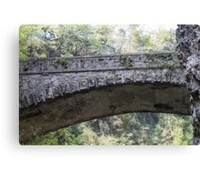 old bridge in the mountain Canvas Print