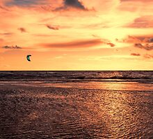 Kitesurfing At The Sunset by Roger Green
