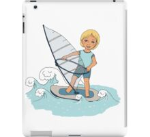 Smiling child rides on waves a board for windsurfing iPad Case/Skin