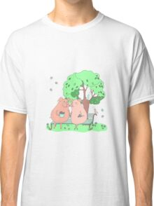 Couple of cute pigs sitting on a bench under a tree Classic T-Shirt