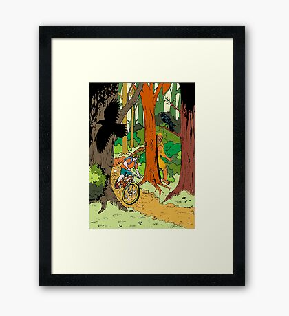 Mountain biking through the forest Framed Print