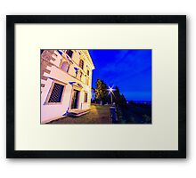 Sunset from a hill with a church down to the vineyards Framed Print