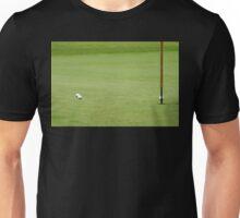 Golf balls near flagstick Unisex T-Shirt