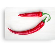 Two red hot chili pepper closeup  Canvas Print