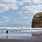 woman in high heels on beach by morrbyte