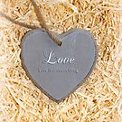 wooden love heart in saying love is a sweet thing by morrbyte
