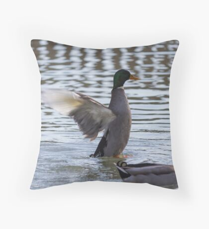 ducks are swimming in the lake Throw Pillow