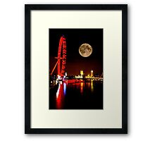 London Eye in red & Parliament by night Framed Print
