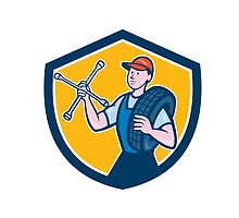 Mechanic With Tire Wrench Shield Cartoon by patrimonio