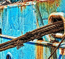 ropes and rust, detail of a ship by travel4pictures
