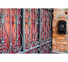 Detail of an old building with an iron fence Photographic Print