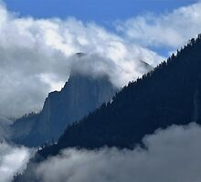 Half Dome Amid The Clouds - Yosemite National Park, Mariposa County, CA by Rebel Kreklow