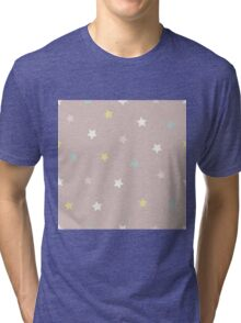 Stars in yellow, pink, white and blue on a pinky brown background Tri-blend T-Shirt