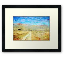 Grunge country road through meadows Framed Print