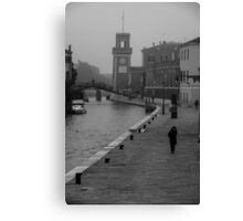 Walking by the canal Canvas Print