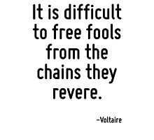 It is difficult to free fools from the chains they revere. Photographic Print