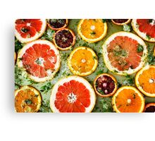 Background from ripe red oranges and grapefruits  Canvas Print