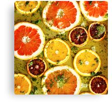 Ripe red oranges and grapefruits cut by rings Canvas Print