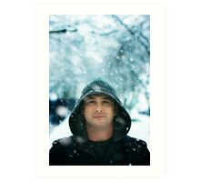 Winter Portrait of a man wearing hood in snow Art Print