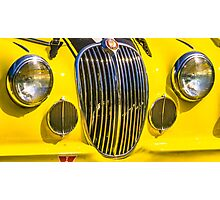 Yellow Jaguar and Grill Photographic Print