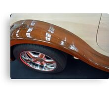 Detail of wooden car and tyre Canvas Print