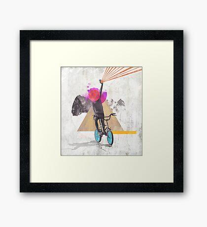 Rainbow child riding a bike Framed Print