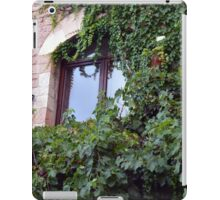 Window on a brick facade covered in leaves iPad Case/Skin