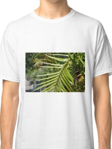 Tropical background with large green palm branch Classic T-Shirt
