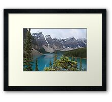 Snow topped mountains at Moraine Lake Framed Print
