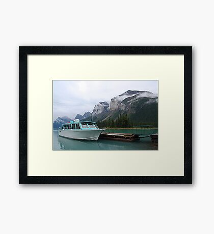 Atmospheric mountains at Maligne Lake Framed Print