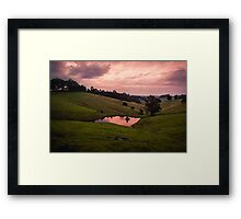 Sunsets in the water Framed Print