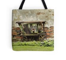 The old wooden wheel barrow Tote Bag