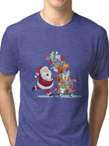 Cartoon Santa Claus pushing a Christmas shopping cart overflowing with tumbling gifts Tri-blend T-Shirt