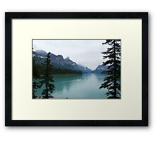 Canoeing into the unknown, Maligne Lake Framed Print