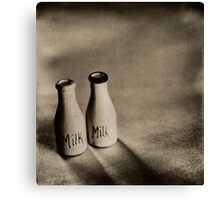 Small vintage milk bottles on monochrome background Canvas Print