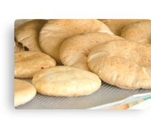 Freshly baked pita bread in a bakery  Canvas Print