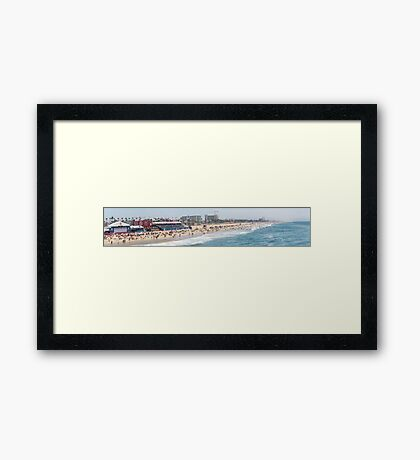 panoramic view of holiday makers on the Huntington Beach, California Framed Print