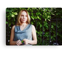 Young calm woman in the park Canvas Print
