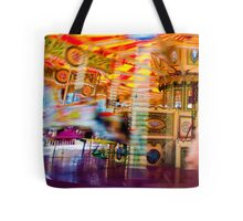 View of Carousel with horses on a carnival Merry Go Round Tote Bag