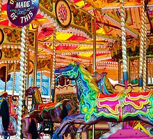 View of Carousel with horses on a carnival Merry Go Round by Stanciuc