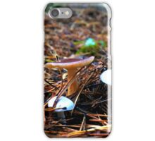 three young mushroom in a clearing among the pine needles iPhone Case/Skin