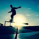 Skateboarder silhouette on a grind by homydesign