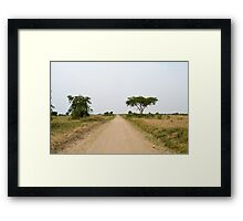 road in the African savanna Framed Print