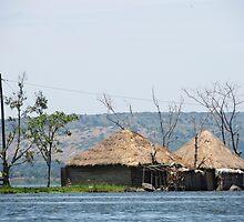 african hut on water by spetenfia