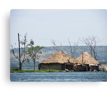 african hut on water Canvas Print