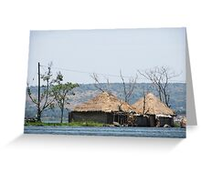 african hut on water Greeting Card