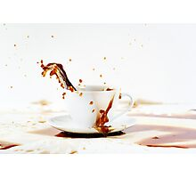 Cup of spilling coffee creating beautiful splash Photographic Print